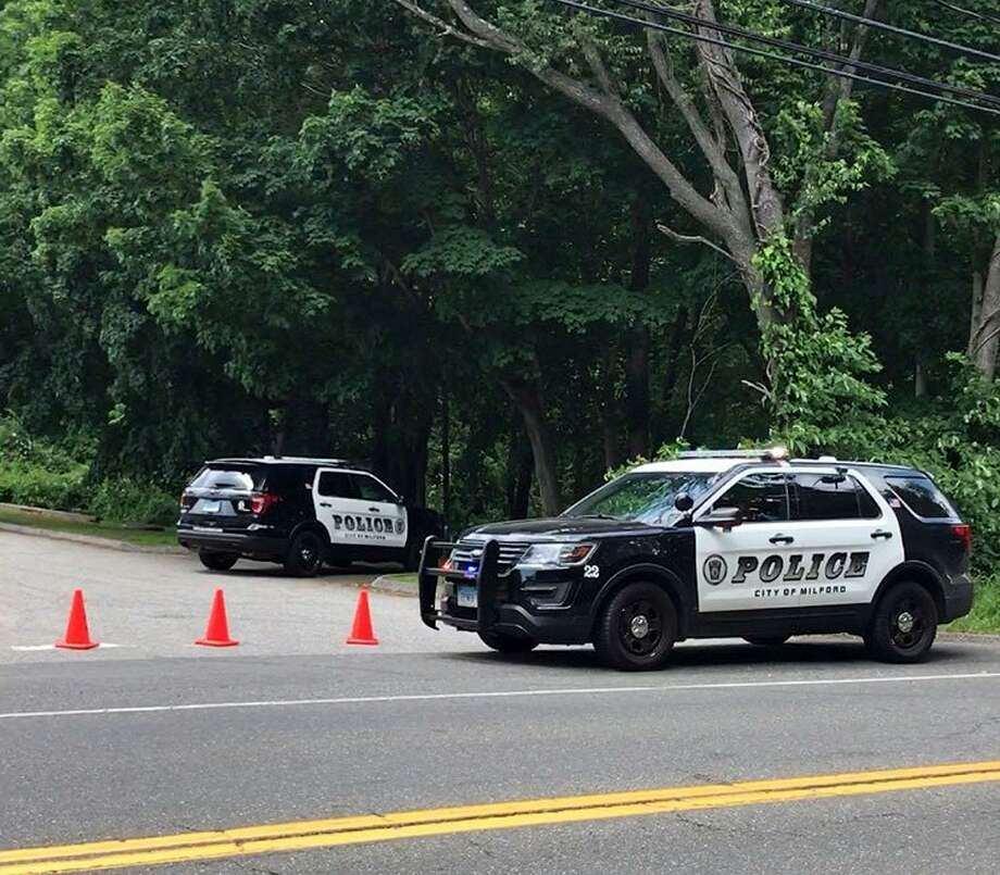 Reports of an emotionally disturbed man in Eisenhower Park in Milford, Conn., led to a significant police presence in the area on Tuesday, June 13, 2017. Milford police confirmed shortly after 3 p.m. that the man was found dead of a self-inflicted gunshot wound. Photo: Tara O'Neill / Hearst Connecticut Media / Connecticut Post