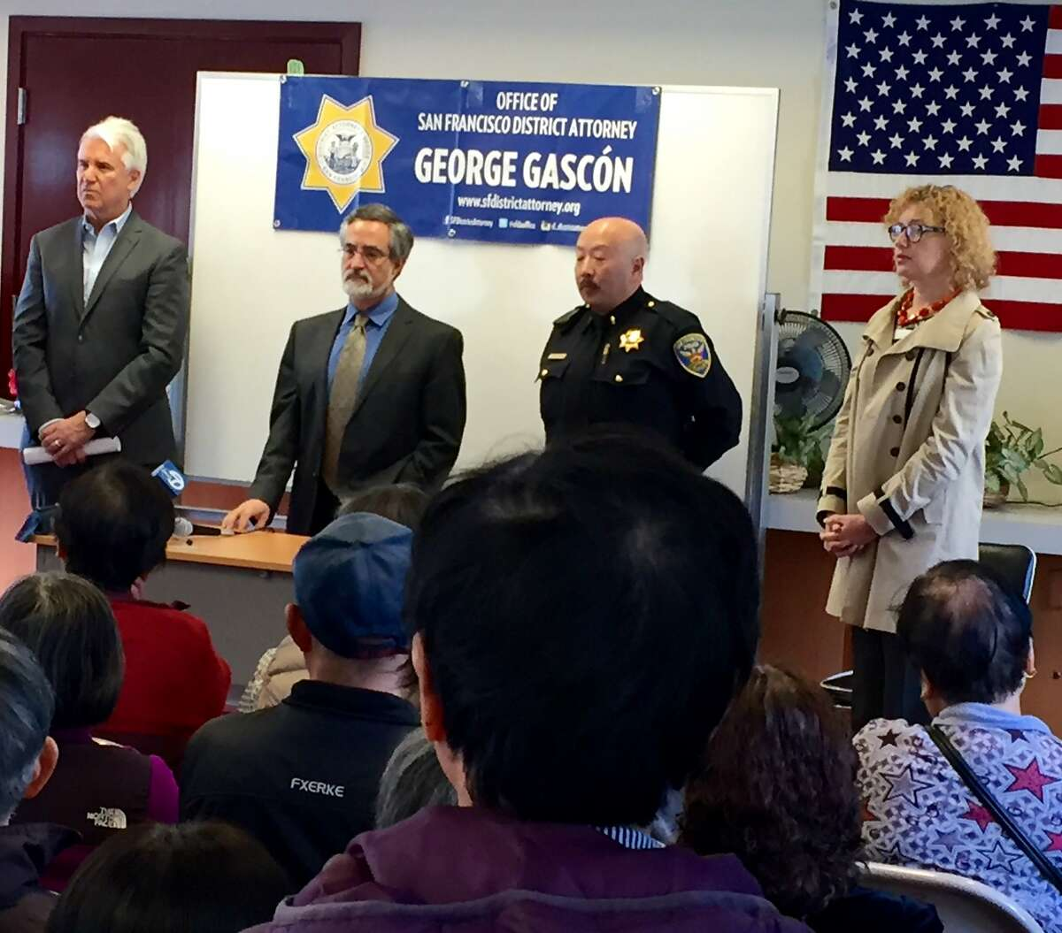 San Francisco officials, including District Attorney George Gascón, Supervisor Aaron Peskin and police Lt. Jodi Kato, warn Chinatown residents to be on alert for the