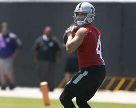Quarterback Derek Carr practices with wide receivers during a workout at the Oakland Raiders practice facility in Alameda, Calif. on Tuesday, June 13, 2017.