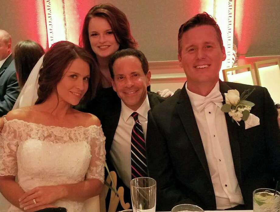 Bride Fiona Gorostiza of KSAT-TV and her country-singing groom Matt Caldwell flank Dallas-Fort Worth meteorologist Evan Andrews, one of the many friends who attended their St. Anthony Hotel wedding. Photo: Courtesy Of Fiona Gorostiza