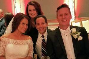 Bride Fiona Gorostiza of KSAT-TV and her country singing groom Matt Caldwell flank Dallas-Fort Worth meteorologist Evan Andrews, one of the many friends who attended their St. Anthony Hotel wedding.