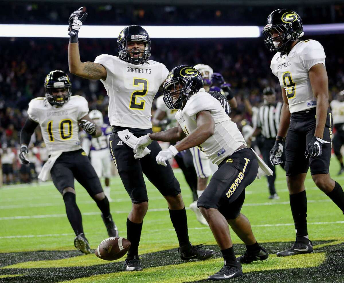 Grambling State University players celebrate the game-winning touchdown made by Martez Carter, second right, during the fourth quarter of the Southwestern Athletic Conference Championship Game against Alcorn State University at NRG Stadium Saturday, Dec. 3, 2016, in Houston. The Tigers defeated the Braves 27-20. ( Yi-Chin Lee / Houston Chronicle )