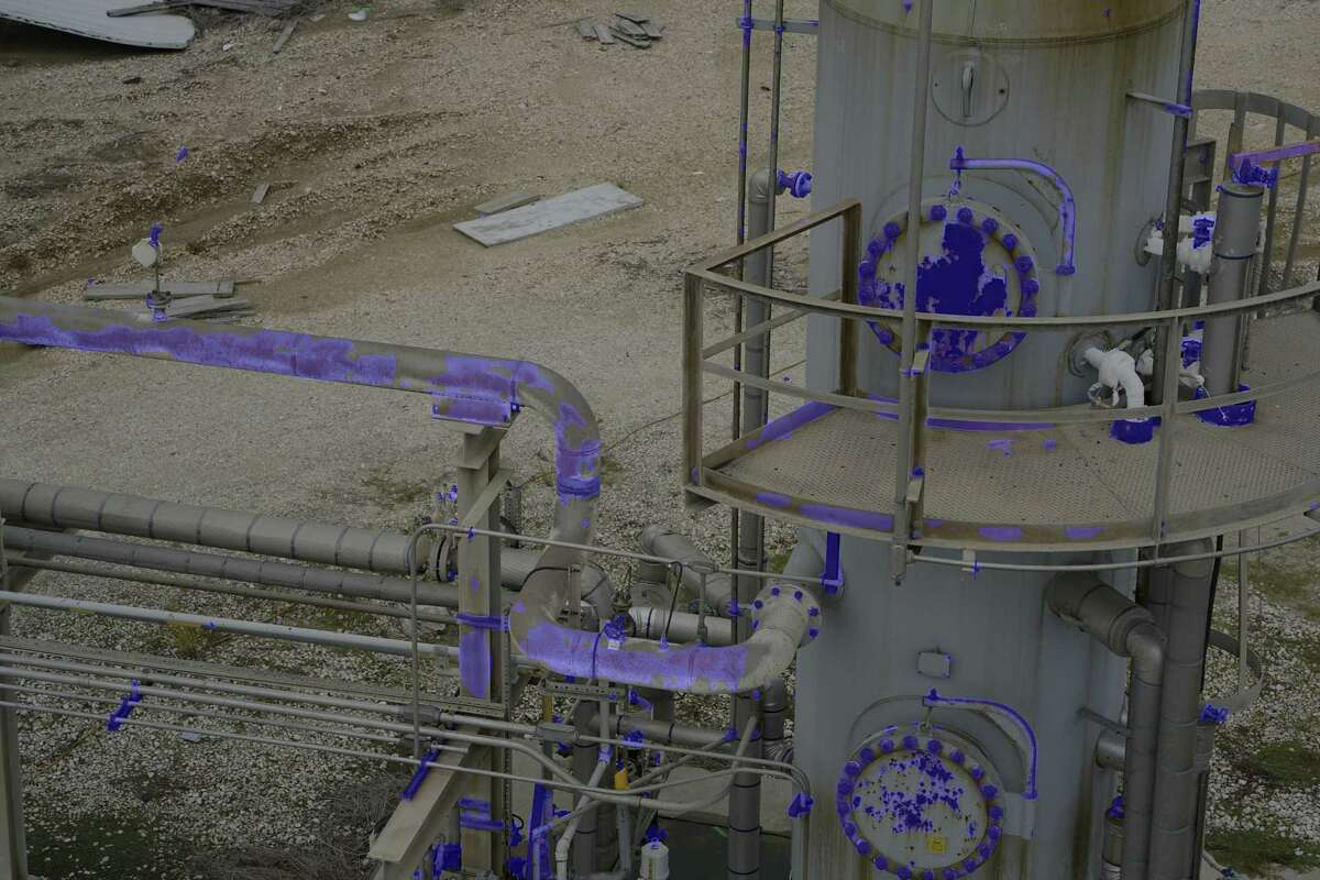 A photo of of oil and gas piping taken by a GE drone. The blue color represents corrosion detection.