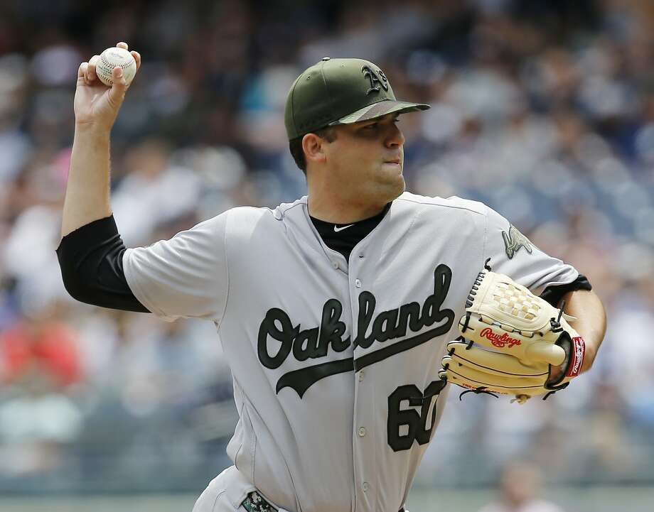 Oakland Athletics starting pitcher Andrew Triggs (60) delivers during the first inning of a baseball game against the New York Yankees in New York, Sunday, May 28, 2017. (AP Photo/Kathy Willens) Photo: Kathy Willens, Associated Press