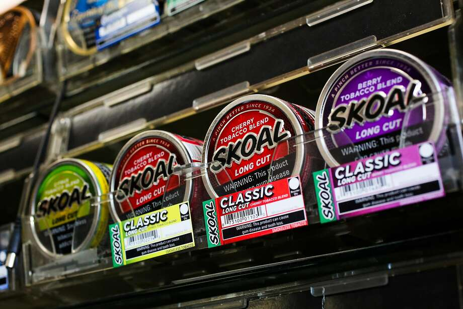 FILE – Flavored tobacco is seen on the shelves at City Smoke and Vape Shop in San Francisco in this file photo from Sunday, June 11, 2017. Oakland, SF's neighbor to the East, is the latest California city to ban flavored tobacco. Photo: Gabrielle Lurie, The Chronicle