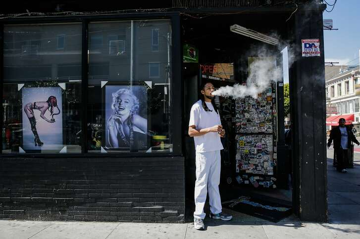 Store employee Khalil G. takes a smoke break outside of City Smoke and Vape Shop in San Francisco, California, on Sunday June 11, 2017.