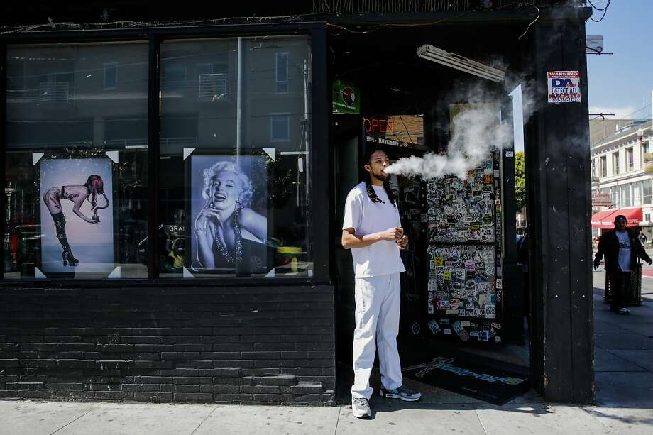 Store employee Khalil G. takes a smoke break outside of City Smoke and Vape Shop in San Francisco, California, on Sunday June 11, 2017. Photo: Gabrielle Lurie, The Chronicle