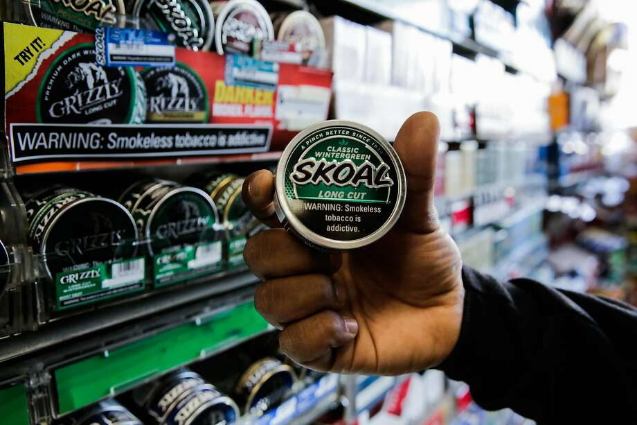 Employee Majid Abbas shows off a package of flavored tobacco at City Smoke and Vape Shop in San Francisco, California, on Sunday June 11, 2017. Photo: Gabrielle Lurie, The Chronicle