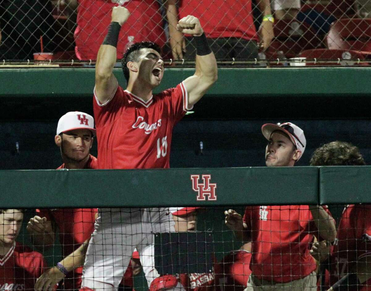 Houston catcher Connor Wong (10) celebrates Corey Julks's (24) RBI double in the sixth inning of the 2017 NCAA Regional Game 5 at Darryl and Lori Schroeder Park Sunday, June 4, 2017, in Houston. Houston Cougars defeated Iowa Hawkeyes 7-5. ( Yi-Chin Lee / Houston Chronicle )