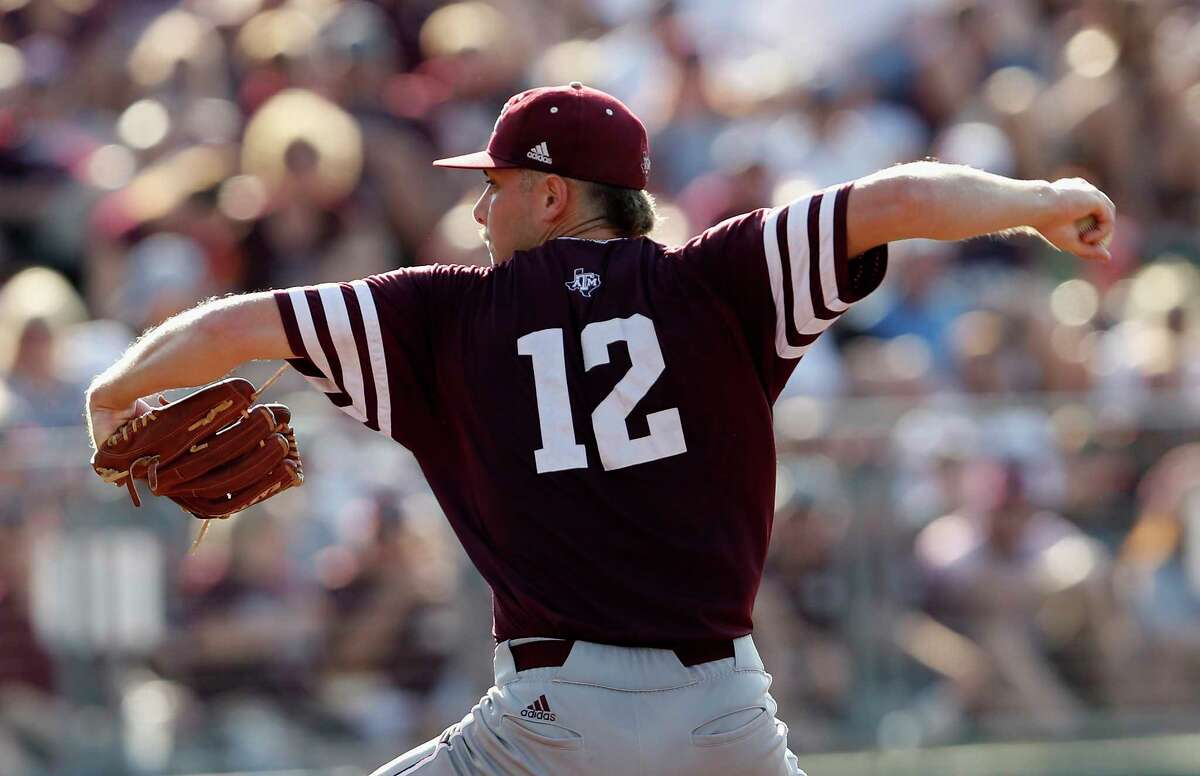 Texas A&M pitcher Corbin Martin (12) pitches in the fourth inning during the 2017 NCAA Super Regional baseball game between the Davidson Wildcats and the Texas A&M Aggies at Blue Bell Park on Saturday, June 10, 2017, in College Station, TX.