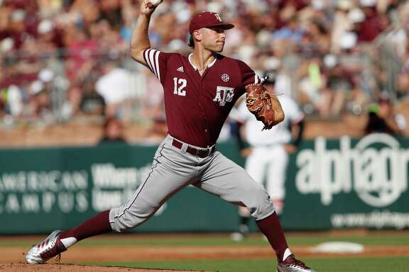 Texas A&M pitcher Corbin Martin (12) pitches in the first inning during the 2017 NCAA Super Regional baseball game between the Davidson Wildcats and the Texas A&M Aggies at Blue Bell Park on Saturday, June 10, 2017, in College Station, TX.