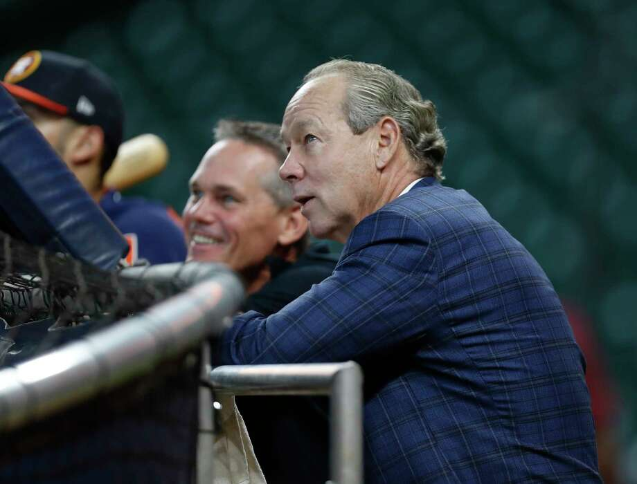Houston Astros owner Jim Crane chats with Craig Biggio during batting practice before the start of an MLB game at Minute Maid Park, Tuesday June, 13, 2017. Photo: Karen Warren, Houston Chronicle / 2017 Houston Chronicle