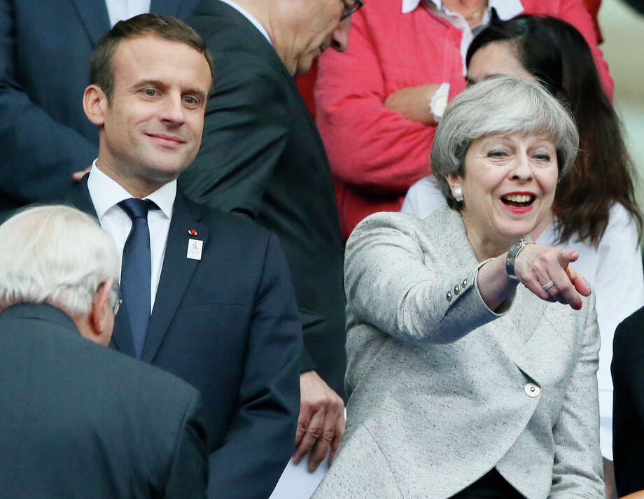 French President Emmanuel Macron and Britain's Prime Minister Theresa May attend a friendly soccer match between France and England at the Stade de France in Saint Denis, north of Paris, France, Tuesday, June 13, 2017. After their talks at the Elysee Palace, the two leaders watch a France-England football match that will honor victims of extremist attacks in both countries. (AP Photo/Francois Mori Photo: Francois Mori, STF / Copyright 2017 The Associated Press. All rights reserved.