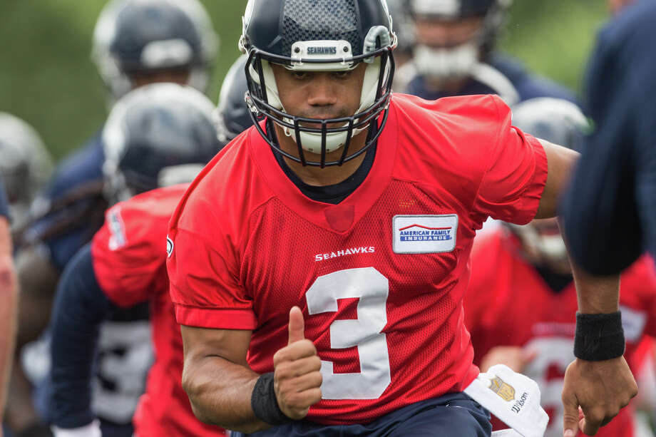 Seahawks quarterback Russell Wilson runs an agility drill during Seahawks minicamp on Tuesday, June 13, 2017. Photo: GRANT HINDSLEY, SEATTLEPI.COM / SEATTLEPI.COM