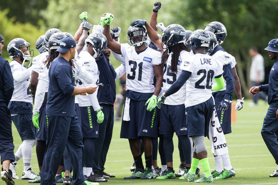 Defense huddles around cornerback Kam Chancellor during Seahawks minicamp on Tuesday, June 13, 2017. Photo: GRANT HINDSLEY, SEATTLEPI.COM / SEATTLEPI.COM