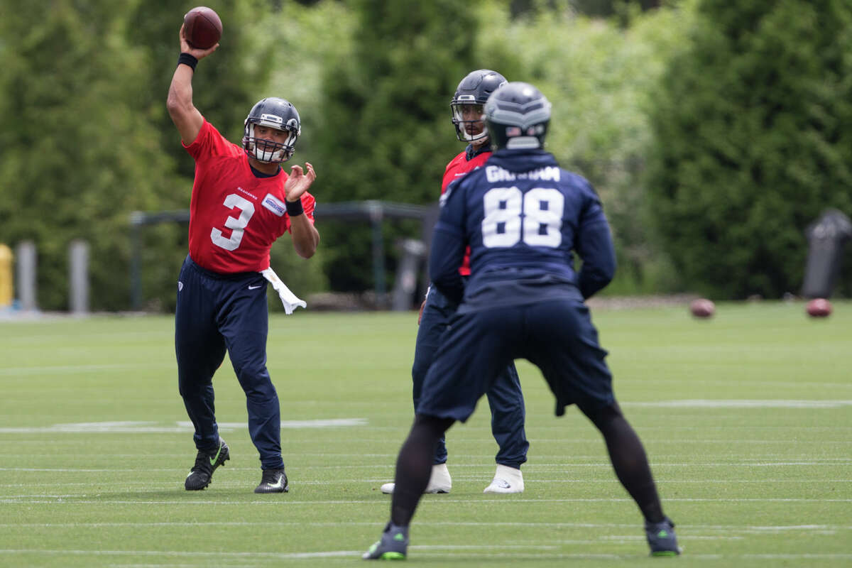 Quarterback Russell Wilson throws a pass to tight end Jimmy Graham during Seahawks minicamp on Tuesday, June 13, 2017.
