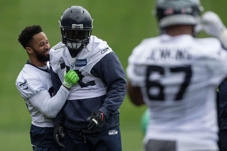 Defensive end Michael Bennett and free safety Earl Thomas goof around during a drill to begin during Seahawks minicamp on Tuesday, June 13, 2017. Photo: GRANT HINDSLEY, SEATTLEPI.COM / SEATTLEPI.COM
