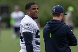 Linebacker Bobby Wagner talks on the sidelines during Seahawks minicamp on Tuesday, June 13, 2017.