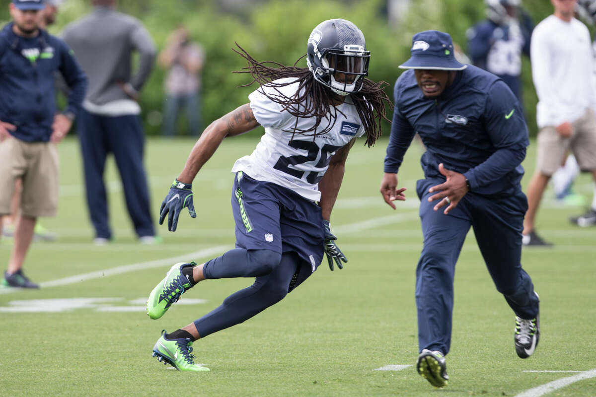Cornerback Richard Sherman runs a drill during Seahawks minicamp on Tuesday, June 13, 2017.
