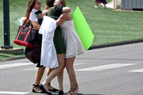 Graduate Elizabeth Chamiec-Case gets a hug from her sister Linda Chamiec-Case and cousin Anna Chamiec, left, before the 2017 Commencement Exercises of Newtown High School, on Tuesday afternoon, June 13, 2017, at the O'Neill Center, Western Connecticut State University, Danbury, Conn.