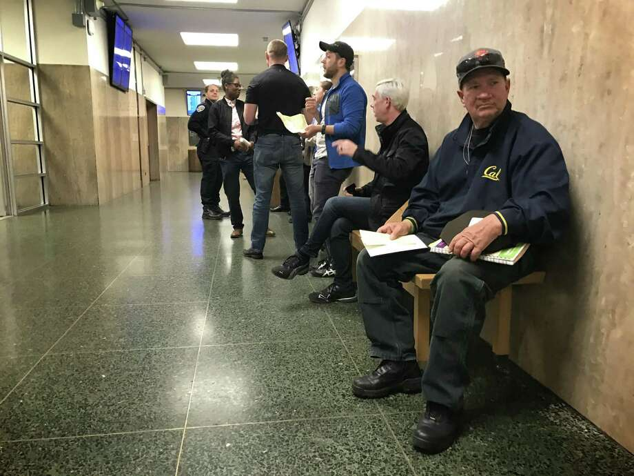 Daniel McHugh, 64, sits outside traffic court Tuesday in San Francisco, where a ticket he got in March for eating pizza at a bus stop was dismissed by a judge. Photo: Evan Sernoffsky / The Chronicle / /