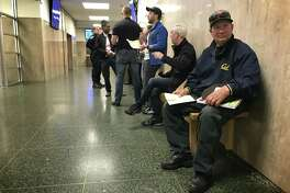 Daniel McHugh, 64, sits outside traffic court Tuesday in San Francisco, where a ticket he got in March for eating pizza at a bus stop was dismissed by a judge.
