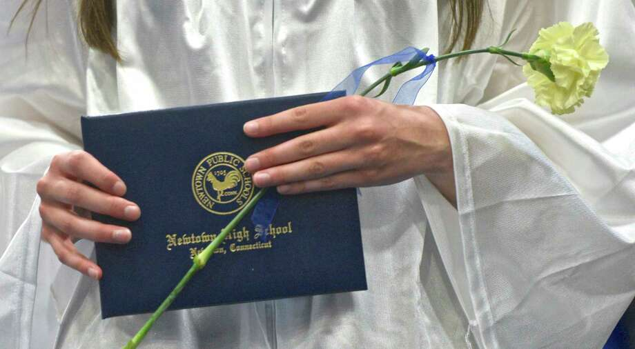 The 2017 Commencement Exercises of Newtown High School, on Tuesday afternoon, June 13, 2017, at the O'Neill Center, Western Connecticut State University, Danbury, Conn. Photo: H John Voorhees III, Hearst Connecticut Media / The News-Times