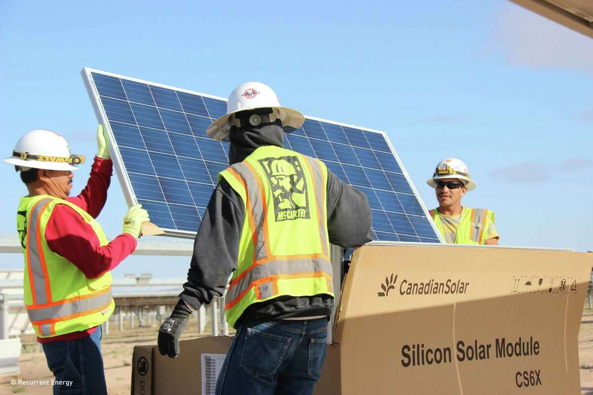 Recurrent Energy, which is owned by Canadian Solar, installs solar panels on the Roserock Solar farm in Pecos County.