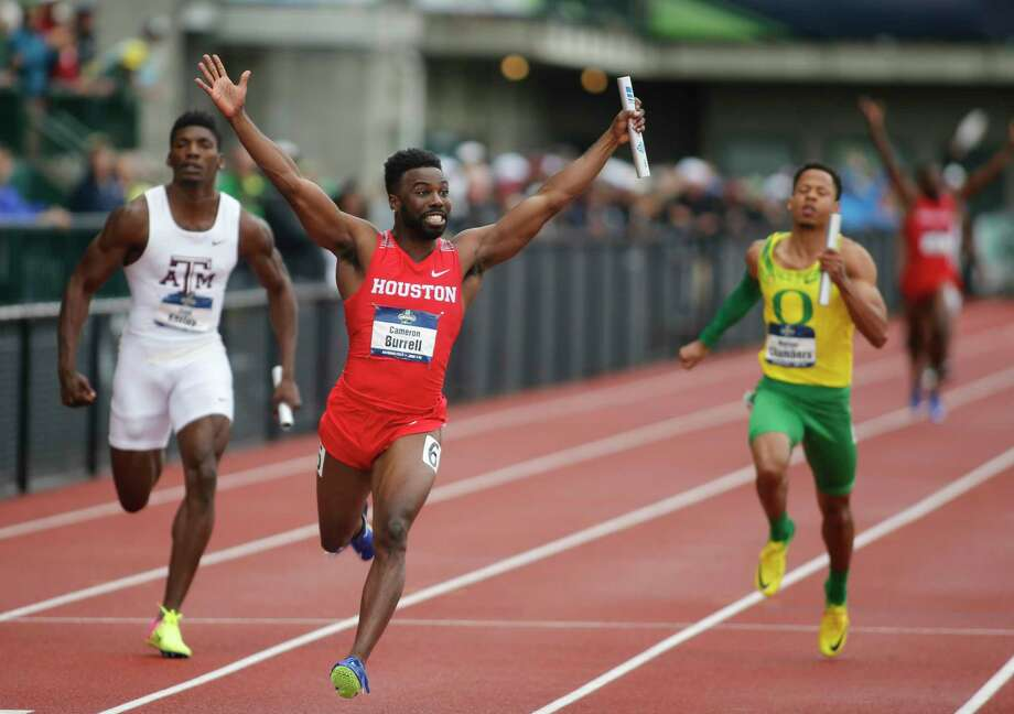 Houston's Cameron Burrell raises his arms in victory in after crossing the finish line in the men's 400-meter relay on the third day of the NCAA outdoor college track and field championships in Eugene, Ore., Friday, June 9, 2017. Houston's wining time was 38.34 seconds (AP Photo/Timothy J. Gonzalez) Photo: Timothy Gonzelez, FRE / FR11177 AP