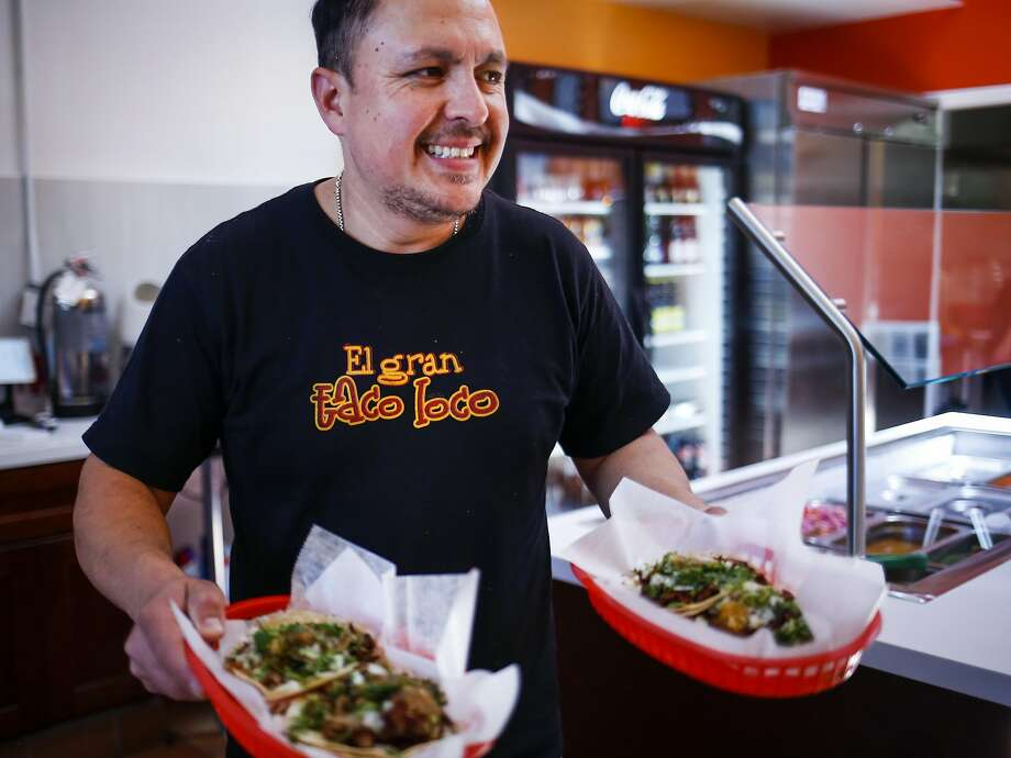 Saul Chavez delivers food to customers in his newly reopened El Gran Taco Loco in the Excelsior. Photo: Nicole Boliaux, The Chronicle