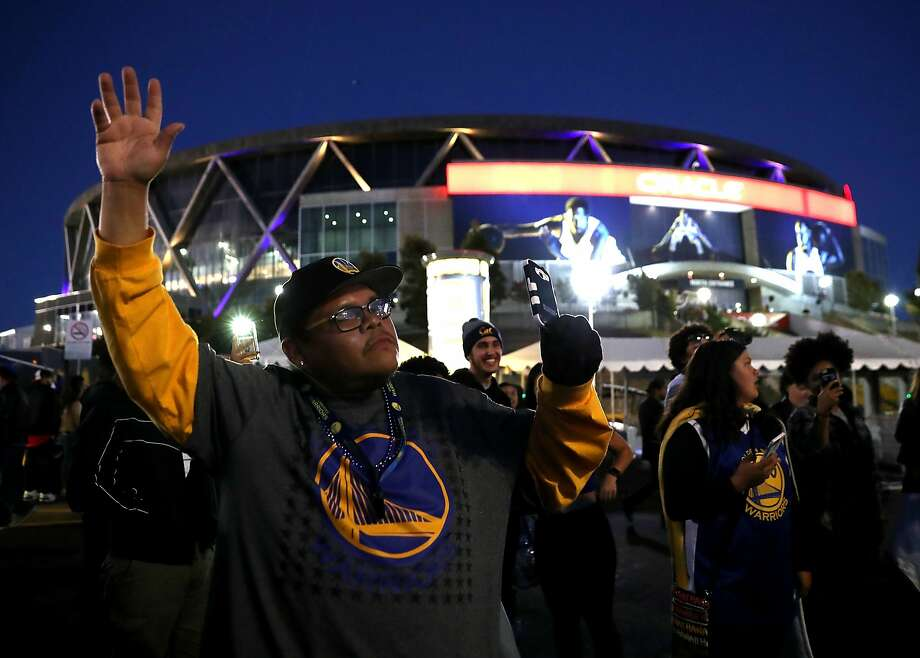 Golden State Warriors fans celebrate outside Oracle Arena on Monday. Photo: Justin Sullivan, Getty Images
