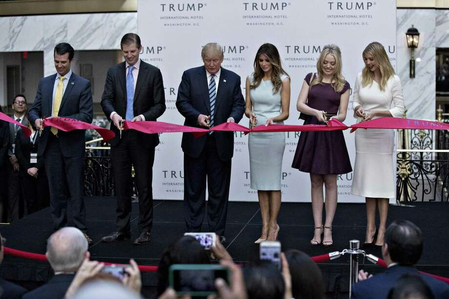 Donald Trump, 2016 Republican presidential nominee, center, cuts a ribbon with his sons Donald Trump Jr., from left, Eric Trump, his wife Melania Trump and his daughters Tiffany Trump and Ivanka Trump during the grand opening ceremony of the Trump International Hotel in Washington, D.C., U.S., on Wednesday, Oct. 26, 2016. Photo: Andrew Harrer / Bloomberg / © 2016 Bloomberg Finance LP