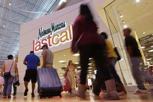 FILE - In this Friday, Nov. 25, 2016, file photo, shoppers walk by a Neiman Marcus Last Call department store in Miami. Neiman Marcus is focusing on offering more exclusive merchandise and more personalized offers to drive sales as it goes it alone to turn around its business. The department store chain confirmed Tuesday, June 13, 2017, that talks for a partial sale or outright purchase of the company have ended. (AP Photo/Alan Diaz, File)