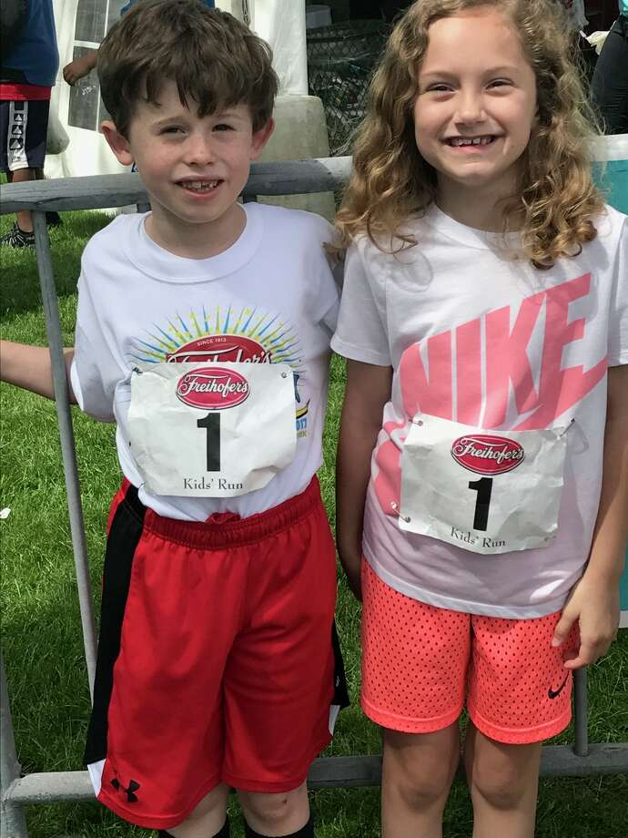 Liam Moynihan of North Greenbush and Fiona Ordway of Albany were among the participants in the Kids 400 meter run at the Freihofer?s Run for Women June 3 in Albany.