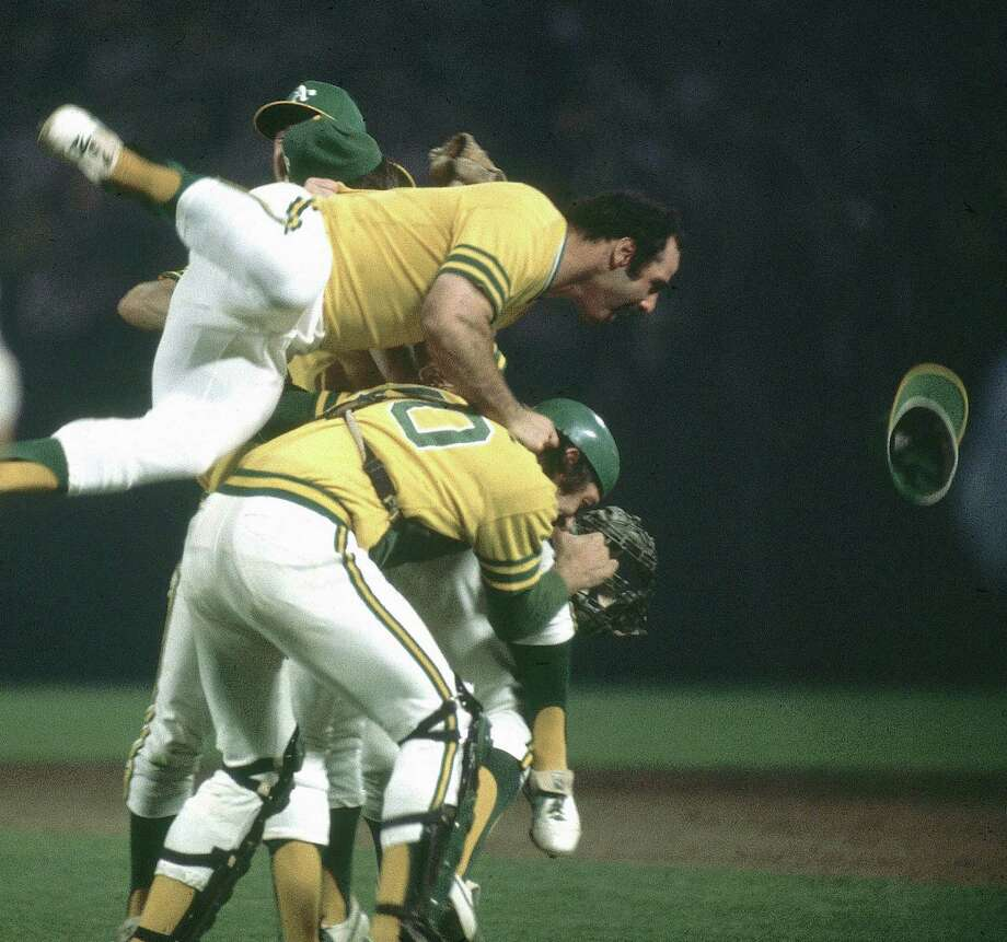 OAKLAND, CA - OCTOBER 17:  Sal Bando #6 of the Oakland Athletics jumps on top of teammates after defeating the Los Angeles Dodgers in Game 5 of the World Series on October 17, 1974 in Oakland, California.  (Photo by Herb Scharfman/Sports Imagery/Getty Images) Photo: Herb Scharfman/Sports Imagery / Getty Images / 1974 Herb Scharfman/Sports Imagery