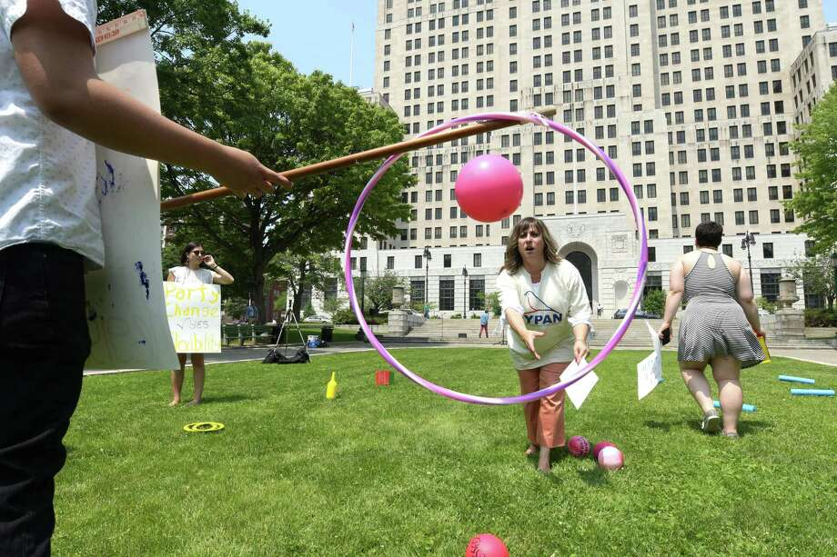 Assemblywoman Christine Pellegrino plays the part of a voter as she tries to make it through the obstacle to voting course during an event in West Capitol Park held by groups pushing for easier access to voting for those living in New York State on Tuesday, June 13, 2017, in Albany, N.Y.   (Paul Buckowski / Times Union) Photo: PAUL BUCKOWSKI / 40040762A