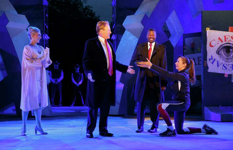 """Tina Benko, left, portrays Caesar's wife, Calpurnia, and Gregg Henry, center left, portrays Julius Caesar during a dress rehearsal of The Public Theater's Free Shakespeare in the Park production of """"Julius Caesar"""" in New York. (Joan Marcus/The Public Theater via AP) Photo: Joan Marcus, HONS / ©2017 Joan Marcus"""