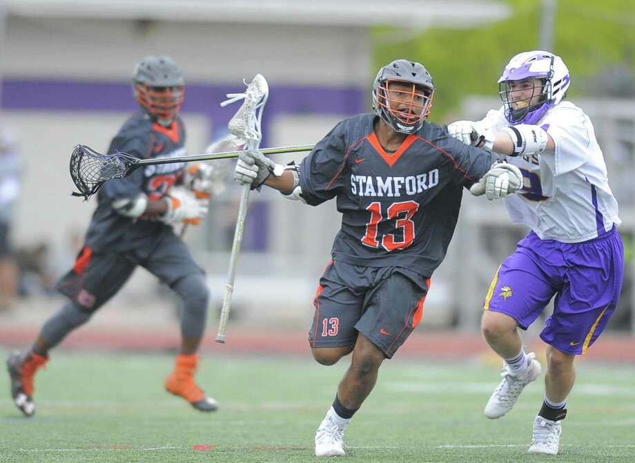Stamford Scott Moreau is checked from behind by Westhill anthony Loccona in a varsity boys lacrosse game at Westhill High School J.Walter Kennedy Stadium in Stamford, Conn. on April 27, 2017. Stamford defeated Westhill 7-6. Photo: Matthew Brown / Hearst Connecticut Media / Stamford Advocate