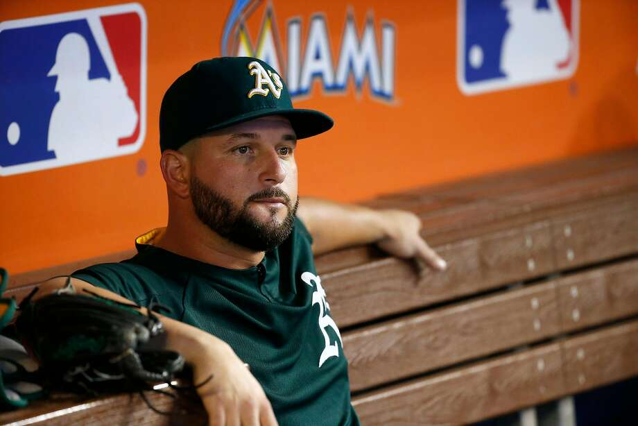 Oakland Athletics first baseman Yonder Alonso looks from the dugout before the start of a game against the Miami Marlins at Marlins Park in Miami on Tuesday, June 13, 2017. (David Santiago/El Nuevo Herald/TNS) Photo: David Santiago, TNS
