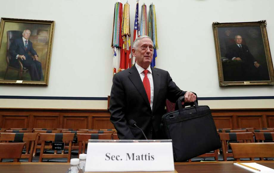 Defense Secretary Jim Mattis sets his briefcase down before he testifies at a House Armed Services Committee hearing on the defense budget for the 2018 budget year, on Capitol Hill, Monday, June 12, 2017, in Washington. (AP Photo/Alex Brandon) Photo: Alex Brandon, STF / Copyright 2017 The Associated Press. All rights reserved.