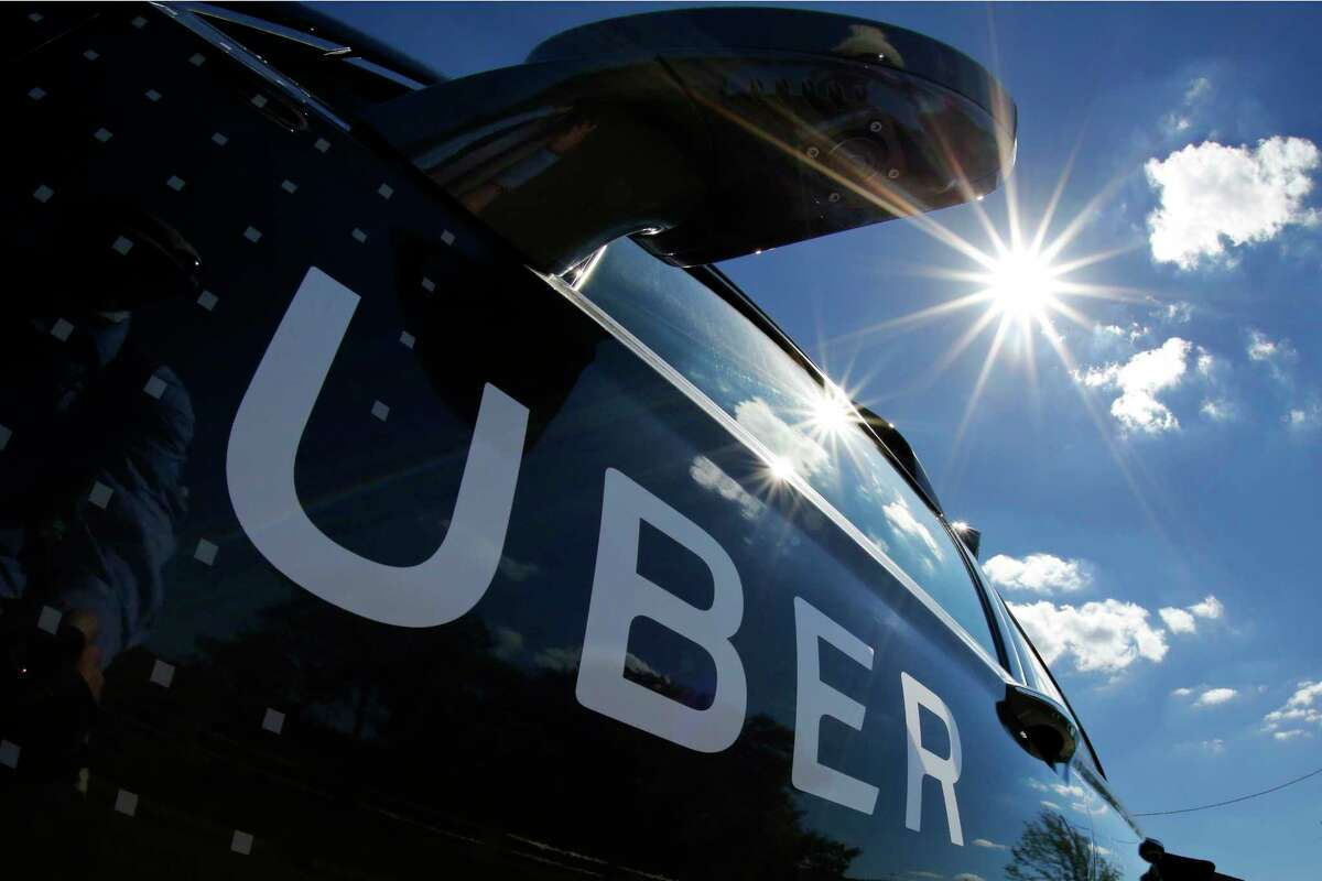 FILE - In this Monday, Sept. 12, 2016, file photo, a self-driving Uber sits ready to take journalists for a ride during a media preview in Pittsburgh. Uber CEO Travis Kalanick will take a leave of absence for an unspecified period and let his leadership team run the troubled ride-hailing company while he?'s gone. Kalanick told employees about his decision Tuesday, June 13, 2017, in a memo. (AP Photo/Gene J. Puskar, File) ORG XMIT: NYBZ290