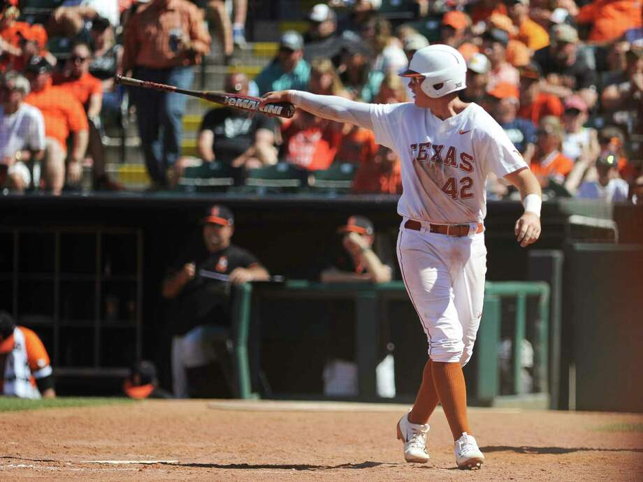 In this May 28, 2017, photo, Texas' Kacy Clemens celebrates after scoring a run in the championship game in the Big 12 baseball tournament in Oklahoma City. Thirty-four years after Texas and pitcher Roger Clemens won the College World Series, two younger Clemenses are chasing another title with the Longhorns. (AP Photo/Kyle Phillips) ORG XMIT: NY155 Photo: Kyle Phillips / AP2017