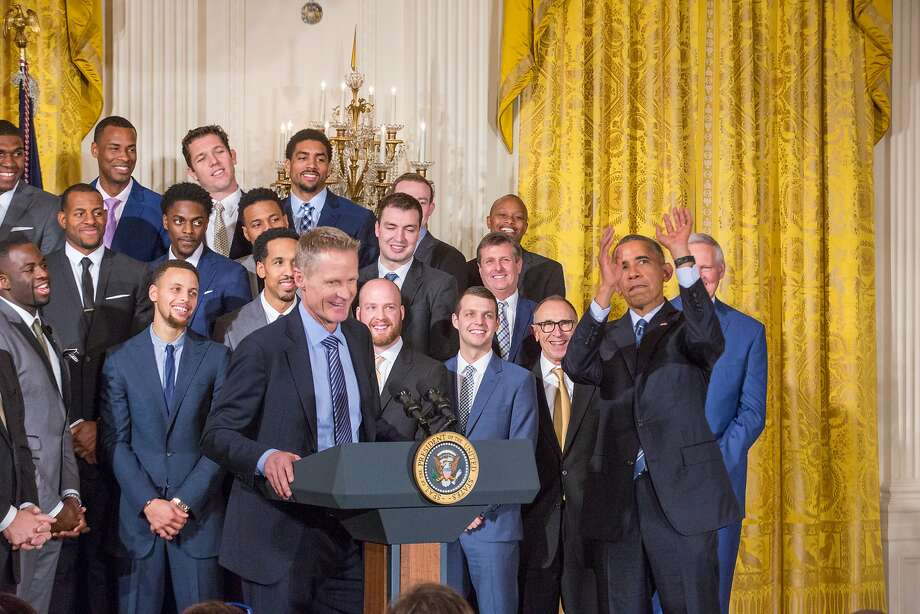 Golden State Warriors head coach Steve Kerr speaks in the East Room of the White House as the team looks on and President Obama pretends to shoot a jumper during the Warriors' visit in February 2016. Photo: NurPhoto, NurPhoto Via Getty Images