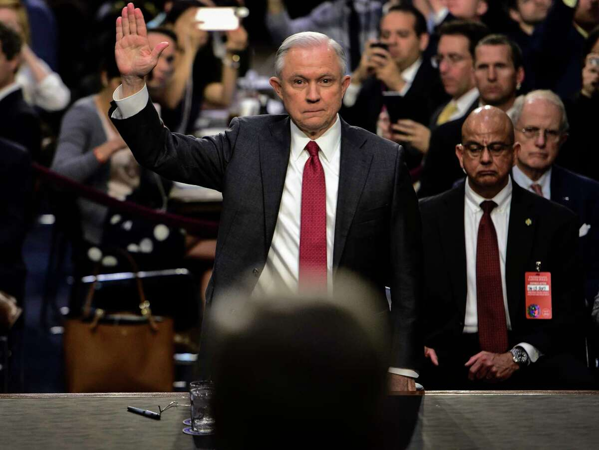 Attorney General Jeff Sessions is sworn in to testify before the Senate Intelligence Committee Tuesday.