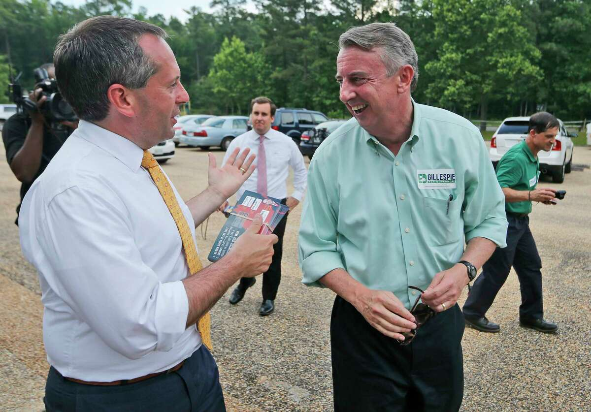 Republican candidate for governor, Ed Gillespie, right, talks with Republican Lt. Gov. candidate Glenn Davis, left, at a polling place Tuesday, June 13, 2017, in Richmond, Va. Gillespie faces State Sen. Frank Wagner and Corey Stewart in today's primary. (AP Photo/Steve Helber)