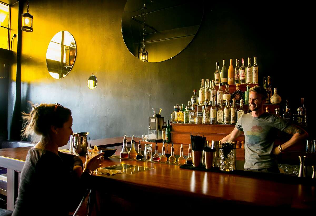 Bartender Decker McKerr talks with a customer at Tequila Mockingbird in San Francisco, Calif. on June 13th, 2017.
