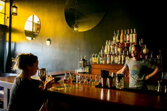 Bartender Decker McKerr talks with a customer at Tequila Mockingbird in San Francisco, Calif. on June 13th, 2017.