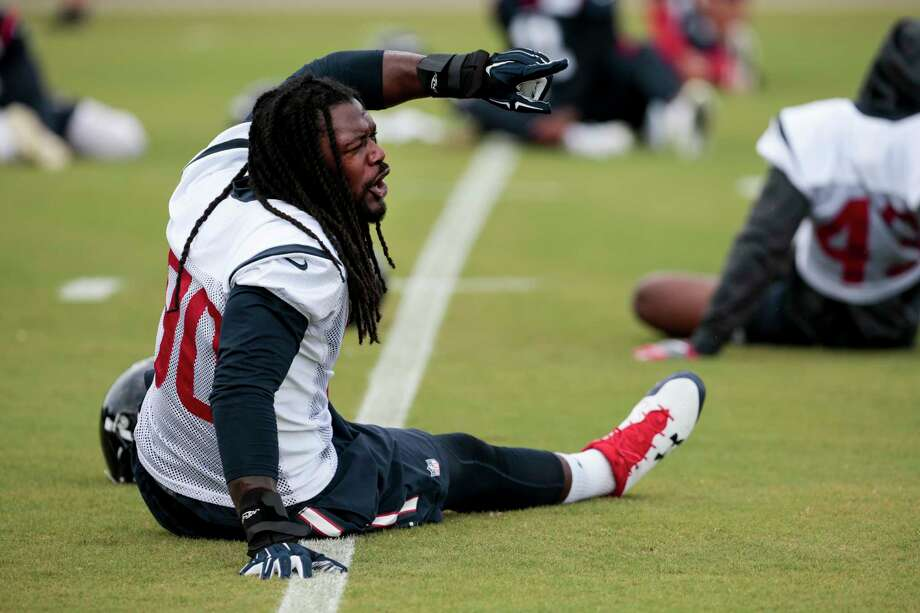 Even while stretching Tuesday, Texans defensive end Jadeveon Clowney stays active at minicamp. Clowney loves that the defensive schemes have him lining up all over and in constant motion. Photo: Brett Coomer, Staff / © 2017 Houston Chronicle