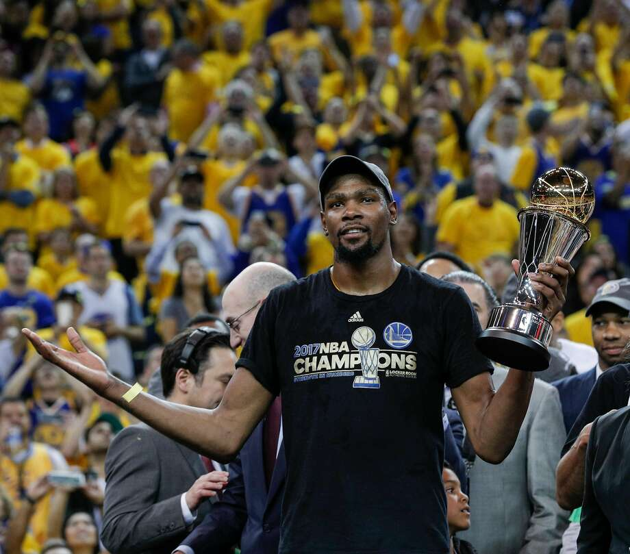 120d29edef2 Golden State Warriors  Kevin Durant holds the The Bill Russell MVP Award after  Game 5