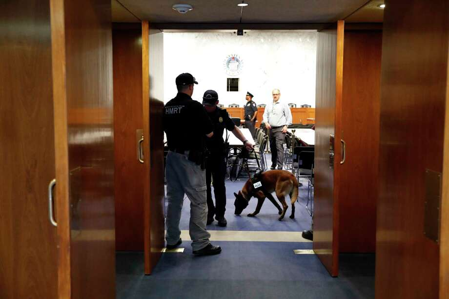 Police sweep a room on Capitol Hill in Washington, Tuesday, June 13, 2017, prior to Attorney General Jeff Sessions testifying before a Senate Intelligence Committee hearing about his role in the firing of James Comey, his Russian contacts during the campaign and his decision to step aside from an investigation into possible ties between Moscow and associates of President Donald Trump.  (AP Photo/Alex Brandon) Photo: Alex Brandon, STF / Copyright 2017 The Associated Press. All rights reserved.